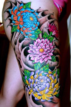 Japanese style leg tattoo. Awesome color! Pick a flower for inside of right bicep