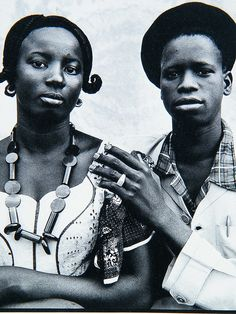 Seydou Keïta lived in Bamako, Mali from 1921 to 2001. A self-taught photographer, he opened a studio in 1948 and specialized in portraiture. Seydou Keïta soon photographed all of Bamako and his portraits gained a reputation for excellence throughout West Africa.