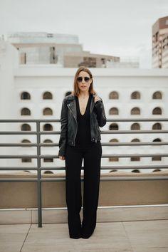 a black jumpsuit - Clothes & Quotes. Black jumpsuit+blac pumps+black leather jacket+ sunglasses. Spring Evening Going Out Outfit 2017