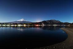 This place is lake Kawaguchiko and Mt.Fuji under the moonlight.
