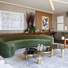 13 Rooms Rocking the Curved Furniture Trend Olive green curved couch and five circular coffee tables matched in different sizes Furniture, Living Room Furniture, Curved Furniture, Living Room Without Sofa, Sofa Design, Curved Couch, Furniture Trends, Couches Living Room, Round Sofa