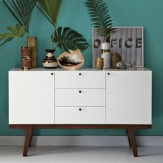 Northern light, heavy on the storage space. Mid-century Scandinavian design inspired this highly detailed white-lacquered media console, which houses three deep drawers and two roomy cabinets, each fitted with an adjustable interior shelf to accommodate books, games and extra blankets. The streamlined, storage-rich piece is lofted on angled solid wood legs in a light pecan stain.