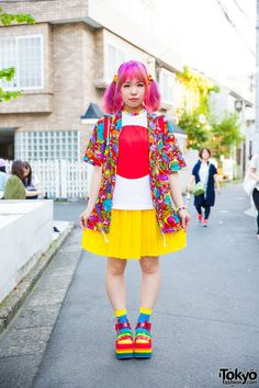 Sasakure on the street in Harajuku wearing a colorful street style featuring resale items from Kinji Harajuku, a Gaspard et Lisa backpack, Candy Stripper platform sandals, and 6%DOKIDOKI accessories.