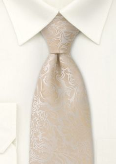 Tired of solid or striped ties for our big day ? Then how about this paisley design in elegant hues of ivory, cream, and champagne. For good reason this tie has been pinned over 150x by our valued customers.