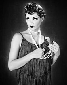Flappers was the start of a new lifestyle in the 1920's. It was when the girls were tired of having to wear heavy clothes and stuff. Flappers wore little clothing, lots of make up, and bead neclaces or feathers. #lifestyle