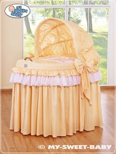 """Cradle of romantic and elegant collection in retro style """"sissi"""". Wicker basket and chasis natural solid wood, beautiful 100% cotton bedding guarantees wooden wheels rubberized to all the safety and mobility for your baby. its  Elegant cap with large knots gives an overall comfort to your baby"""