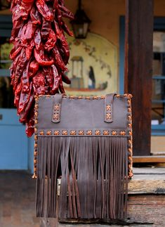 This fringed tote is a statement bag handcrafted by New Mexico artist, Abbie Caplin. Soft leather with a stunning turquoise pig suede interior. Items not in stock will take four to six weeks for delivery. All Tom Taylor products are handmade and are the finest in the world, so be patient. Tom Taylor, Soft Leather, Toms, Turquoise, Tote Bag, Purses, Clutches, Handmade, Mexico
