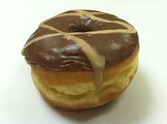 Marble madness!  Simply Crazy Good!  In a traditional mood?  This donut is for you!  A raised donut with chocolate icing and maple drizzle.  Copyright Psycho Donuts, All Rights Reserved.