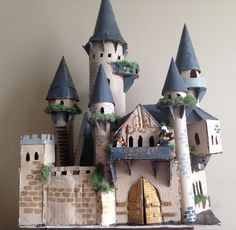 Inspired by a location in my story, I used cardboard, paper towel rolls, and foam board (all recycled of course) to construct my cardboard castle I've mad since I used paint and decorative moss to give it a… Cardboard Castle, Cardboard Crafts, Paper Crafts, Cardboard Paper, Cardboard Houses, Diy Crafts For Kids, Projects For Kids, Art Projects, Craft Ideas
