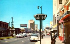 "The stretch of LA's Wilshire Boulevard known as the ""Miracle Mile"" extends from Fairfax Ave to La Brea Ave. It was the brainchild of real estate developer A.W. Ross who wanted to develop Wilshire as a commercial precinct to rival downtown. He called it ""Miracle Mile"" in what we would now call ""branding"" and it became a huge success and encouraged LA to spread west, which in turn helped give rise to LA's car culture. This photo is circa 1958 and is looking west from around Detroit Street."