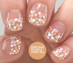 Cute colorful polka dot nails. Love the glossy clear base!