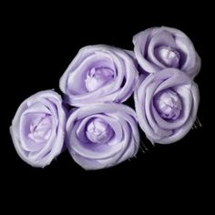 """This bold and stylish floral hair comb is a perfect addition to your perfectly coiffed bridal up-do. Five of these silk-inspired tea roses are fastened securely to a hair comb. This light purple piece will add a touch of floral elegance to any themed wedding.  Size: Adornment measures 5"""" wide x 3.5"""" tall on a 1.5"""" comb"""