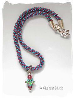 Kumihimo Braided Lampwork Necklace #Kumihimo  #LampworkGlass #BeadedNecklace #CherryChick #LampworkBead