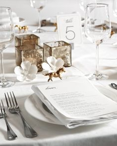 To pay tribute to their Kentucky roots, horse figurines, sprayed gold, stood mid-trot above each place setting. Other table ornamentation included mercury-glass votives and porcelain blooms.