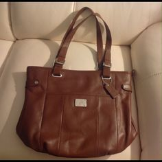 Brand new GENUINE LEATHER purse... Coffee brown handbag....several zippered and snapped compartments...small makeup bag included inside...animal print lining....never been used... Grace Adele Bags Satchels
