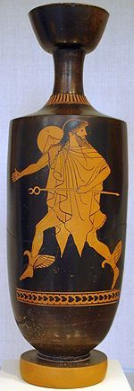 Ancient Greece: Chlamys around his body and a petasos hanging off the back of his neck which is a hat