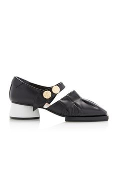 e960ee039d4 This **Reike Nen** pump is rendered in leather and features a buckle