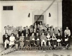 """Topango Air Raid Wardens, July 1942. During World War II, civil defense groups were formed in Topanga Canyon. Volunteers were responsible for making sure every dwelling had blackout curtains in place. The use of the name """"Topango"""" is an old derivation of Topanga. For many years the spelling was inconsistant. The only known people are in the center row, at left is Hugh Harlan, the front row, 4th from left, Edna Bartley. Topanga Historical Society. San Fernando Valley History Digital Library."""