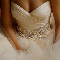 delicate flower waist detail. love the mixing of materials.