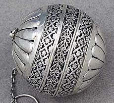 Tea apparatus, 101:  Gorham sterling tea-ball.