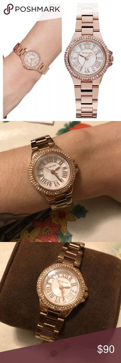 Michael Kors women's rose gold watch MK3253 An excellent condition women's Michael Kors Camille rose gold watch item number MK3253. Comes with watch, original box, original tag, and extra links that have been taken out to fit my wrist. Any Michael Kors store will add or remove links free of charge. Watch is in great condition with hardly any signs of wear on the band. Rose gold in color and crystals around the face, all in tact. Please let me know if you have any questions, thanks for…
