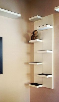 Great idea! use two Lack wall shelves from ikea and stagger them for wall stairs at $49 each, this can be done for under $100.