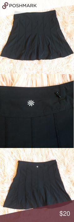 "Athleta black midi skirt 8 Black athleta midi skirt with side zipper and drawstring.  Zippered pocket in the back  Waist-16"" Length-18"" Athleta Skirts Midi"