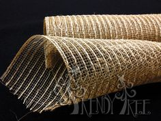 """Natural Burlap and Poly Mesh Roll Color: Natural Burlap Material: 65% Polypropylene; 35% Jute Size: 10"""" in width; 10 yards in length Unique polyester mesh for floral wrapping and decoration."""