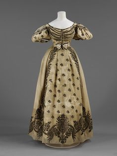 "Wedding Dress, Paris, France (attributed, made), England, Great Britain (worn): 1828, silk crêpe over satin, embroidered with silver, silk lace, embroidered silk shoes.    ""Associated with the marriage of the Honourable Frances Barrington to William Legge, 4th Earl of Dartford in 1828, family history states this was made in Paris"""