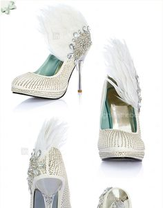Lovely wedding shoes....minus the feather if you were actually going to wear them. :)
