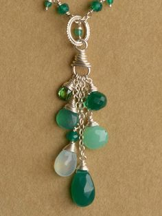 "Mixed length chains with beads gather to make the ""Abundance"" Charm"