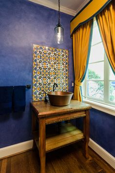 mediterranean powder room, bright blue walls, orange-yellow accents (Benjamin Moore, Autumn Gold)