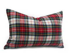 These white and red plaid pillows (foreground) are a must have for a classic country lodge look. They are made with the Weathered Stewart…