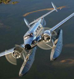 A beautiful Beech 18 cruising above the water