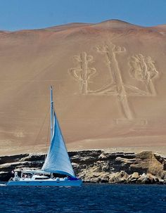 Paracas, Peru ~ the Candelabra of the Andes, a well-known prehistoric geoglyph.  Pottery found nearby radio carbon dates it to 200 BCE.  Cut two feet into the soil, with stones possibly from a later date placed around it, it's 595 ft tall, large enough to be seen 12 miles at sea.  The reason for its creation is unknown, but most likely it represents the trident, a lightning rod of the mythical god Viracocha.