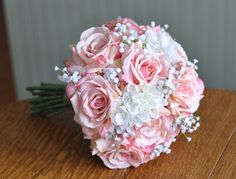 Luscious pink roses, babies breath and hydrangea silk wedding bouquet by Holly's Wedding Flowers.