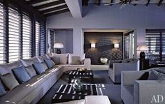 Antigua - Armani used different muted color palettes in the two villas, gray in Villa Flower and beige in Villa Serena. The walls of Villa Flower's living room are sheathed in tatami, and the furnishings are by Armani/Casa.