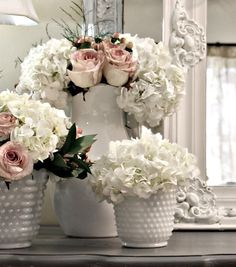 Hydrangeas, roses, and milk glass