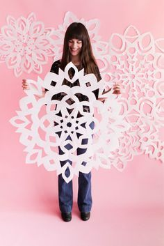 I've been dying to share this idea since last summer. I saw a vintage photo of a man holding a giant paper snowflake and I knew we had to recreate it for the holidays! The concept is super-simple: the