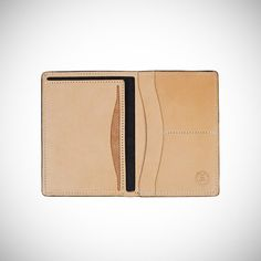 """Ace Hotel x Tanner Goods Passport Wallet // $105. Made from the kind of tough, domestically-sourced, vegetable-tanned, cowhides built to breeze through Customs in all kinds of continents. You can also get it custom-embossed with up to three initials for another 15 bones. Natural and black leather. 4.5"""" x 6.5"""" inches."""