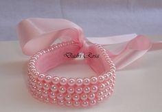 Porta coque de perolas rosa, toda costurada, garantindo assim qualidade e durabilidade.