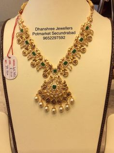 Light weight Exclusive short Haaram ( BIS 91.6 CERTIFIED) . Beautiful gold necklace with peacock design pendant. Necklace with pearl hangings.   25 September 2018