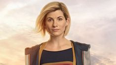 The first female Doctor is wearing boots and braces as part of her costume.