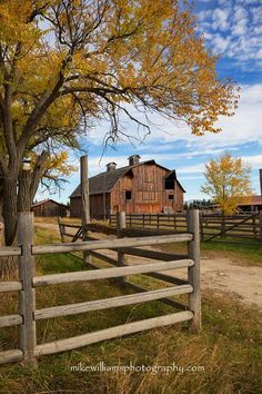 Old barn, blue sky, whispy clouds, wood fence, autumn fall colors...