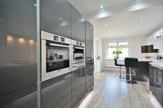 Modern White and Grey Acrylic Kitchen Design with Eye level BOSCH Appliances. Designed, Supplied and Installed by Kitchencraft Essex. Kitchen Dining Living, Home Decor Kitchen, Diy Kitchen, Kitchen Furniture, Stylish Kitchen, Kitchen Storage, Kitchen Ideas, Grey Kitchen Island, Small Kitchen Cabinets