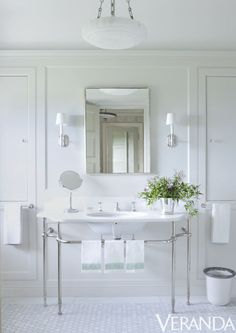 The all-white materials in the master bathroom of a Watch Hill, Rhode Island home lend a fresh, airy personality. The fittings are by Waterworks and the flooring is by Urban Archaeology.   Image originally appeared in the September/October 2013 issue of Veranda.   INTERIOR DESIGN BY MICHAEL S. SMITH
