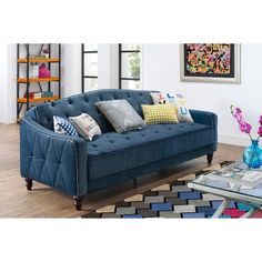 Classic and tailored, this sofa sleeper has a timeless appeal that will add a luxurious feel to any living room. Adapted for a more contemporary aesthetic, this navy velour vintage tufted sofa will take center stage in any living space. Available from Walmart.com.