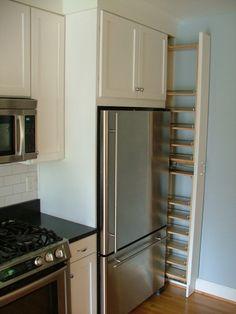 Collamore Built | Full length Spice Rack on side of fridge.  So smart!!