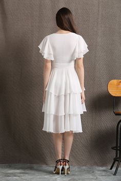 Youll be picture beautiful in this gorgeously floaty and feminine white chiffon dress. The fit and flare style of this summer dress means it will give you a lovely shape. Romantic and elegant, this is a great dress for a summer party or as a prom dress. Youll turn heads for sure. The dress