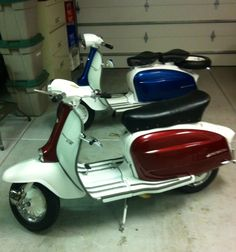 Dad's two restoration projects side by side.  Two original 1963 Lambretta 150 Li III's.  The red and white one is my brother Rich's (he had the scoot for about 20 years and it was in bad shape and no longer running).  The blue and white one is one the I got when Dad decided it would be good to have another one around as a model for the restore job on the first.